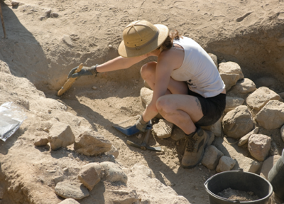 Student at an excavation site participating in an Archaeological Field Practicum